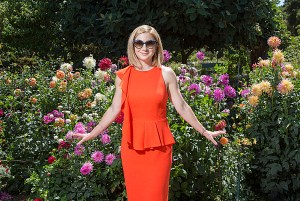 Lady in Orange Dress with Flowers in Background