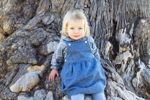 Adorable toddler in a blue dress