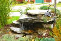 23 Absolutely Stunning Pondless disappearing waterfall designs