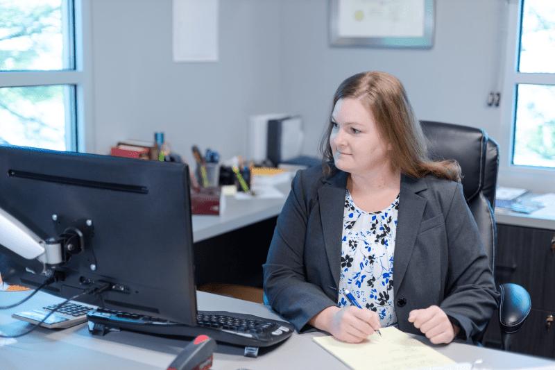 criminal defense attorney working at her desk