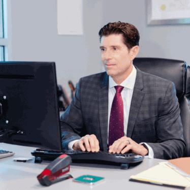 criminal defense lawyer at computer