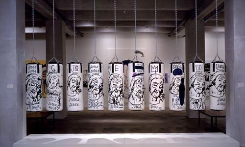 Ten Punching Bags - Art Review
