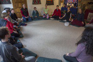 group sitting in a meditation circle