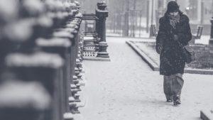 loneliness image, woman walking in rain