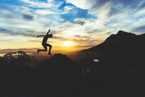 Man leaping on mountain top