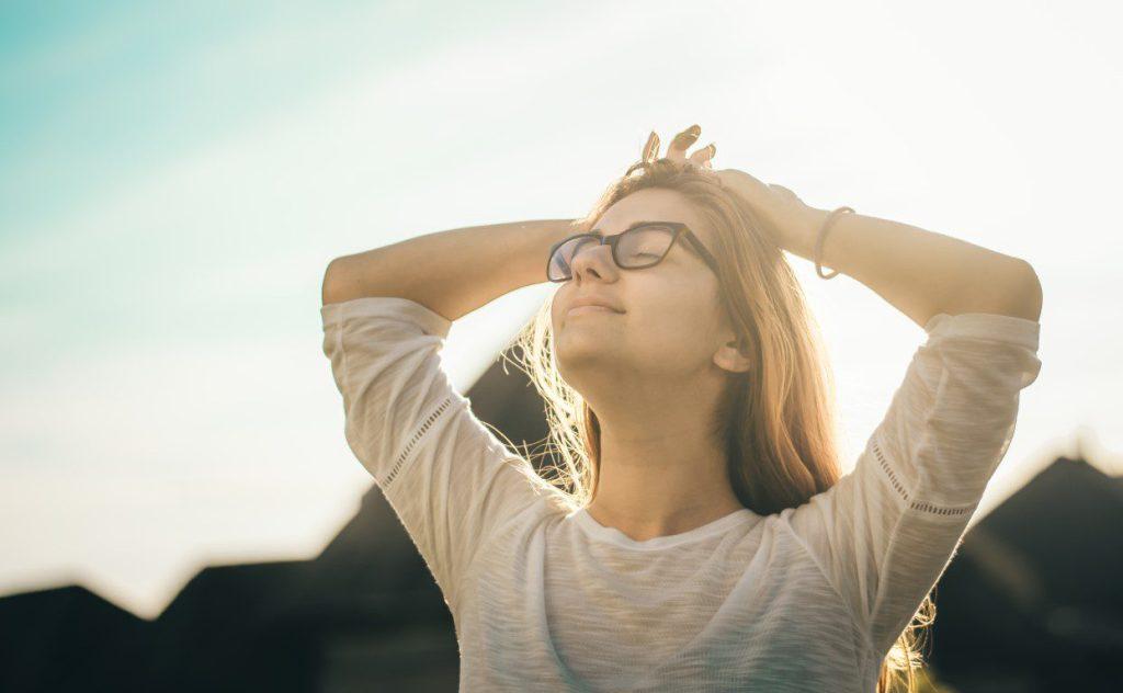 Woman taking a breath of fresh air