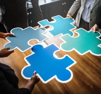 """People putting together the """"business"""" puzzle"""