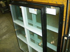 Insulated panels with muntin bars