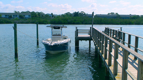 Boat docked at Captains Cove Condos in Indian Shores