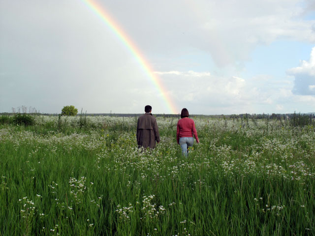 Andrei and his guide Alyona Andronati walk the rich fields of Western Ukraine.