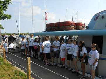 The children line up to board the Holiday fishing boat at Edgewater Park.