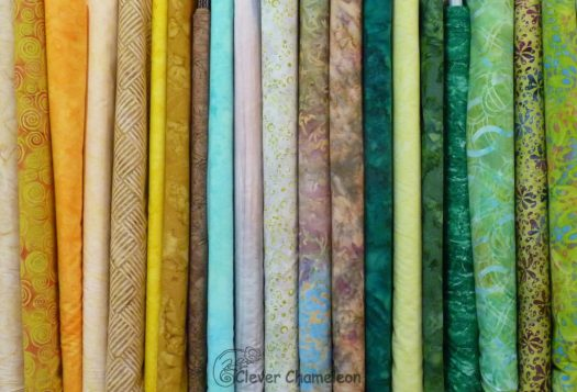 Fabrics lined up in a row.