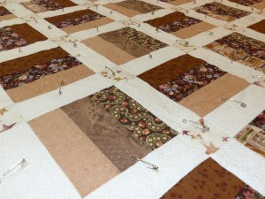 Pin-basted quilt ready for stabilisation