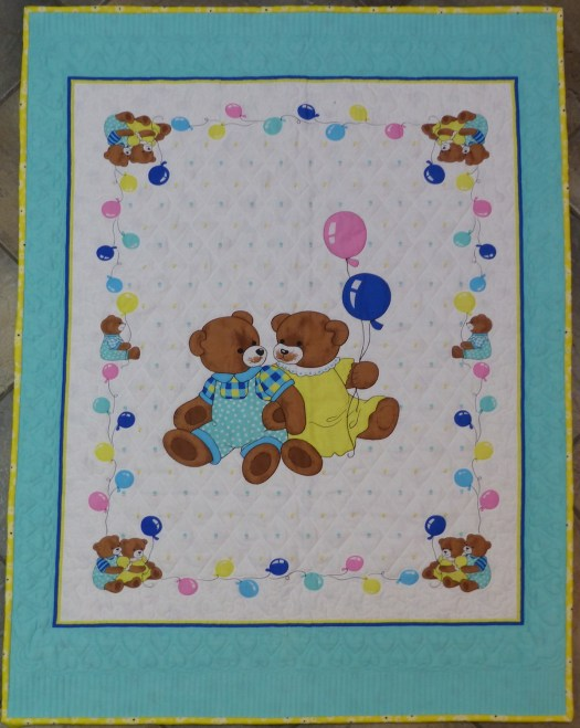 teddy bear printed panel enhanced with free-motion quilting