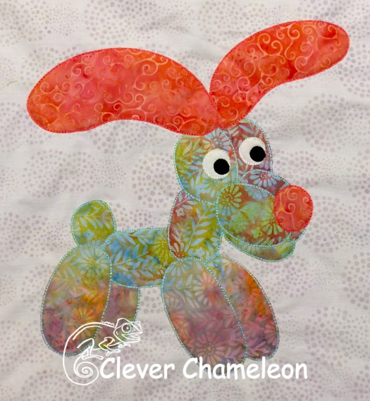 Dippy dog, balloon dog appliqué designed by Dione Gardner-Stephen and available free at Clever Chameleon Quilting during 2019.