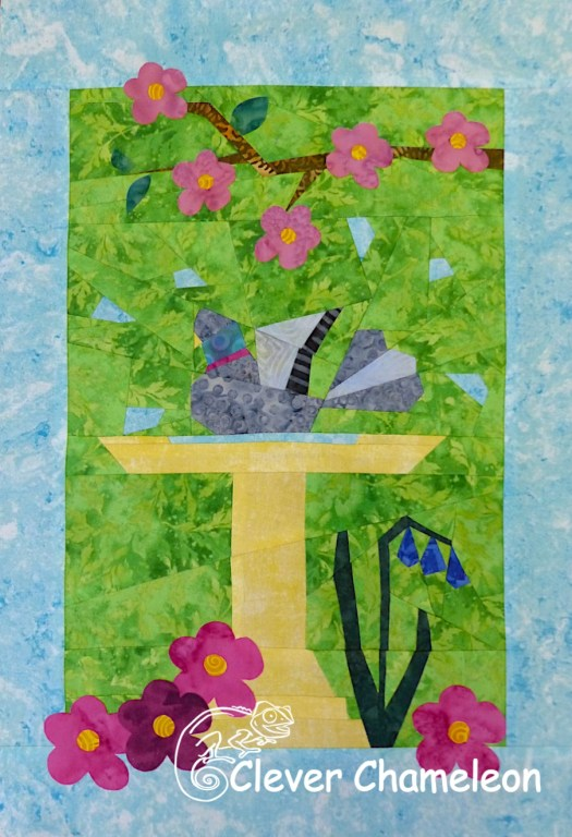 pigeon in a bird bath paper pieced quilt block designed by Dione Gardner-Stephen of Clever Chameleon