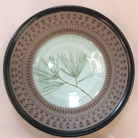 Ceramic bowl by Liz Hyde with impressed pine needles and tooled edges