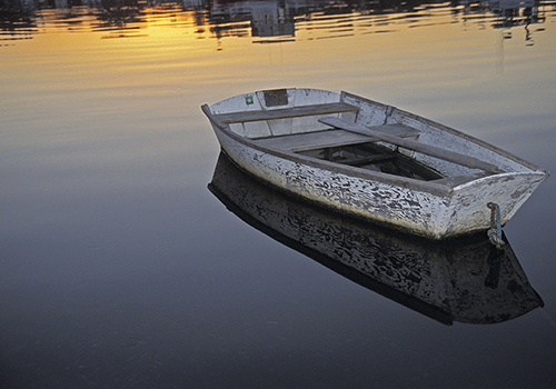 Photograph of small wooden boat by Nancy Rich