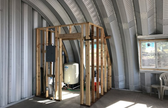 Clever Moderns Quonset hut house construction window installation bathroom