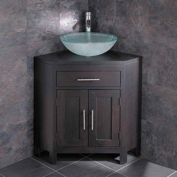 large corner dark oak vanity unit with round frosted glass basin with tap and waste alta