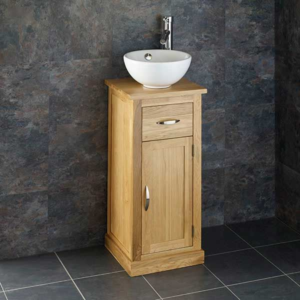 small oak vanity cabinet with round ceramic white basin plus tap and waste