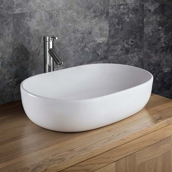 large oval countertop bathroom basin in white ceramic 600mm x 425mm curved freestanding sink alara