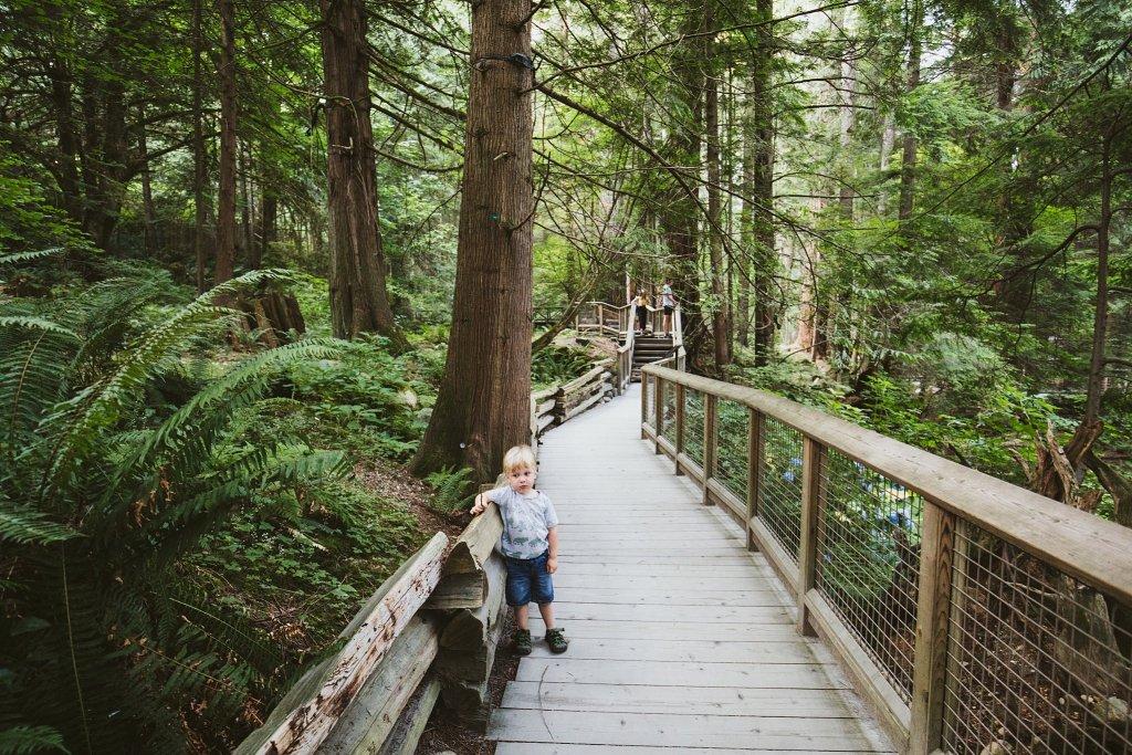 Toddler boy walking on a boardwalk in Vancouver