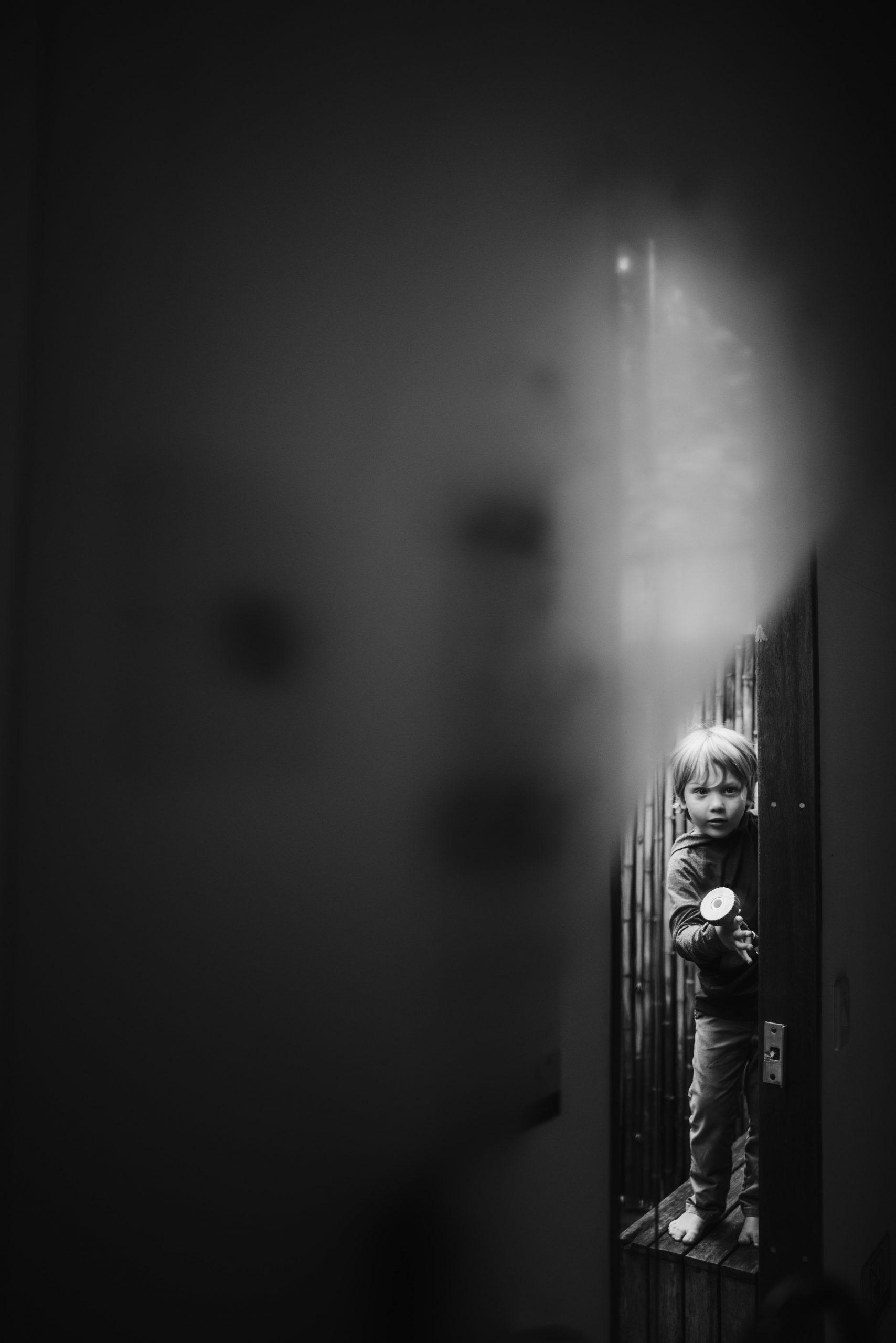 Mirror reflection of little boy