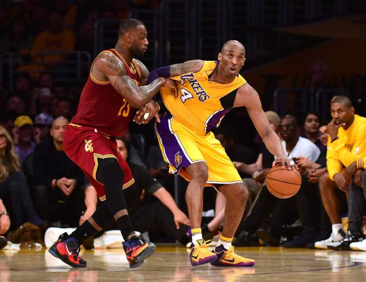 Kobe Bryant backs in on LeBron James in the first half of a game vs. the Cavaliers on March 10, 2016.