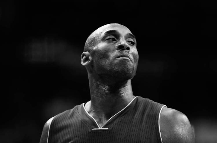 Kobe Bryant, No. 24 on the Los Angeles Lakers, looks on against the Washington Wizards in the first half of a game at Verizon Center on Dec. 2, 2015.