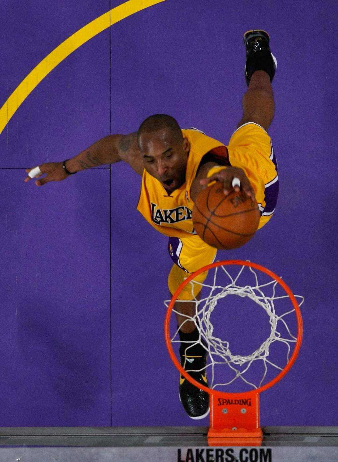 Kobe Bryant dunks with his left hand in the third quarter against the New Orleans Hornets in Game 5 of the Western Conference Quarterfinals in the 2011 NBA Playoffs.