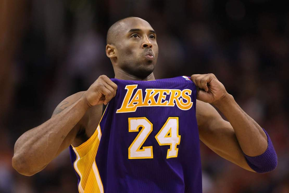 Kobe Bryant adjusts his jersey during a game vs. the Phoenix Suns at the U.S. Airways Center on Feb. 19, 2012.