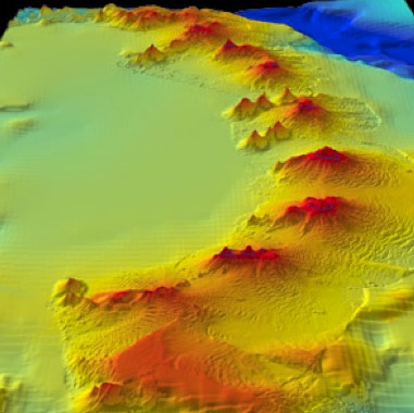 Figure 4: Seafloor image of a 500-mile long string of multiple 3,000-foot high active seafloor volcanoes located adjacent to the northern portion of the Antarctic Continent. (http://aem.asm.org/content/73/7/2230.full).