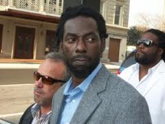 Buju Banton heads to court with long-time friend Gramps Morgan in the background!