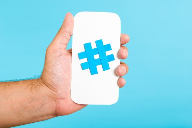 Mobile blue hashtag and hand