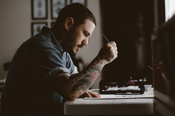 man-with-tattoos-at-work