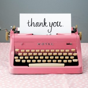 Type writer printing thank you on white paper