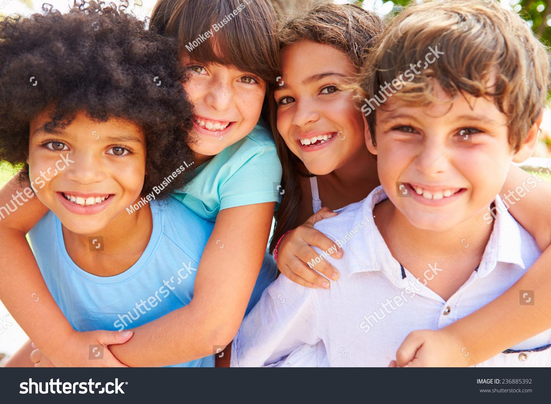 Children huddled near a camera