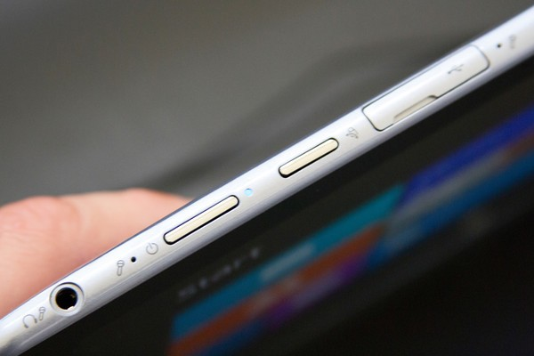 The side view of the ATIV; power button, the something another button, headphone jack and USB port. (Click for full size)