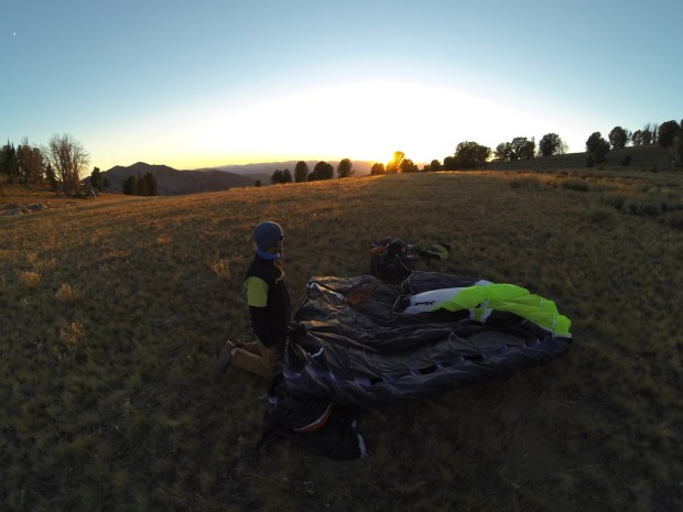 Gavin lands a few feet from the Pioneer Hut at sunset