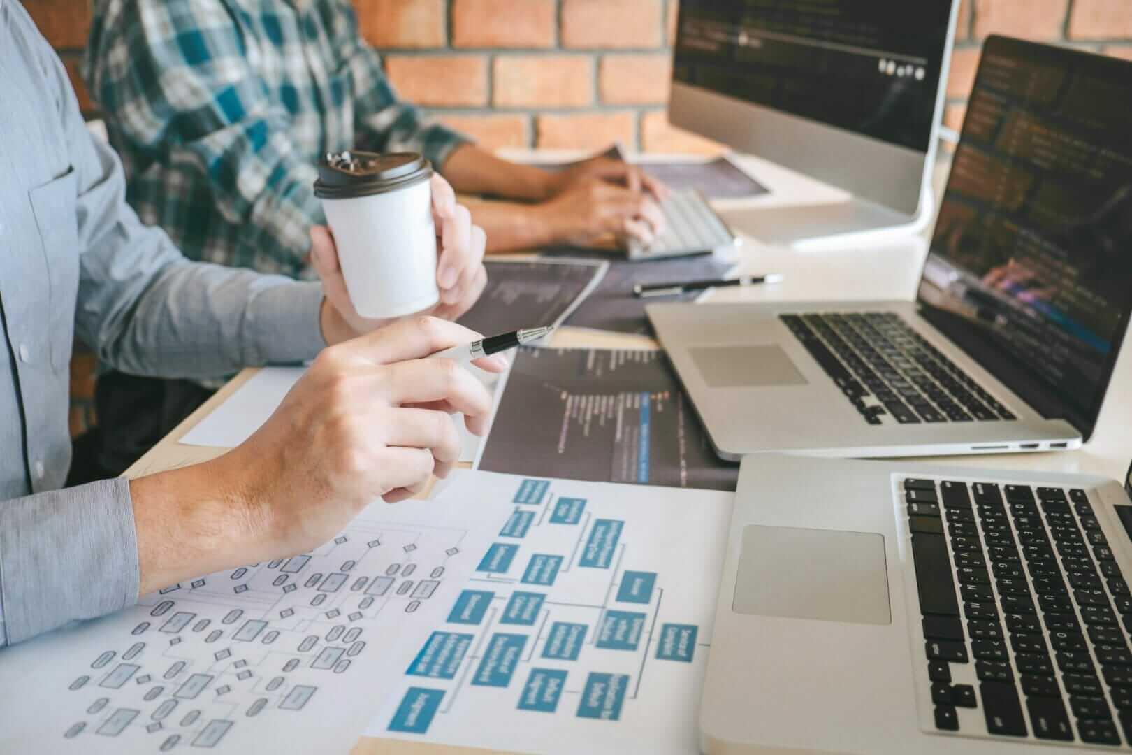 team-professional-developer-programmer-cooperation-meeting-brainstorming-programming-website-working-software-coding-technology