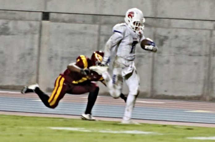 Photo by Ron Sunquist With speed and quickness as his greatest asset Zach Ashford was a standout receiver in football for Buchanan, seen here scoring against Clovis West.