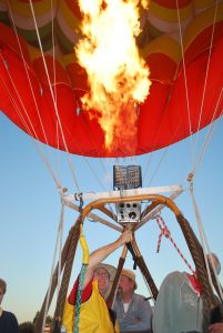 "Pilot Bob Locklin, also known as ""Magic Bob,"" heats up his balloon and gets ready to take flight."