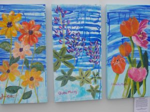 "By J.M. Swezey Painting ""After the Rain"" by cancer survivors Joan Keaton, Orpha Moody and Esther Perez Martin. Artistic Director: Hilda Vandergriff"