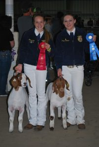 Photos by Valerie Shelton Devyn Palmer and Mikaela Kirk with their award-winning goats.