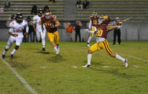 Photo by Jennifer Armstrong Clovis West's Jayden Helms throws a touchdown pass on a trick play on the Eagles first play from scrimmage in their 33-14 victory over Central on October 29. Quarterback Adrian Martinez threw a backwards lateral to Helms who then threw it to Caleb Kelly for an 80-yard touchdown.