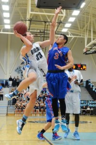 Photo by Nick Baker Clovis North Senior guard Blake Lanseadal puts up a twisting shot towards the end of the Broncos victory over the Bears. Lanseadal was one of five seniors honored on the night.