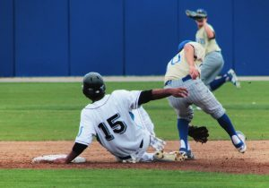 Photo by Ron Sundquist Clovis North's Matt Frazier steals two bases and finally scores a single run at the bottom of the third inning in the Coca Cola Classic Tournament championship game against Clovis High.