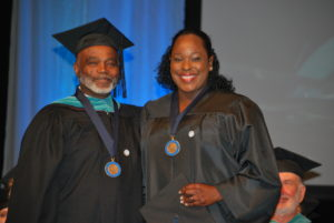 Interim Dean of Instruction Dr. Lee Brown with distinguished business and social sciences graduate Arva Parker.