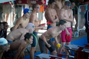 Photo by Ron Webb The Clovis boys 200 free relay team cheer on anchor Zach Koch as they can smell a state title.